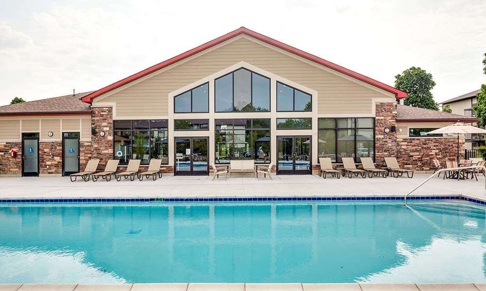 Pool and clubhouse at The Trilogy Apartments