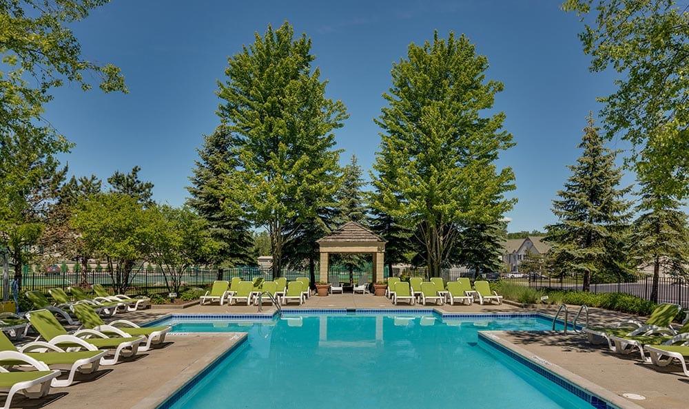 Pool view showcasing cabana and swim deck at Auburn Gate in Auburn Hills
