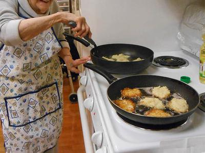 Female Senior Apartment Resident Cooking