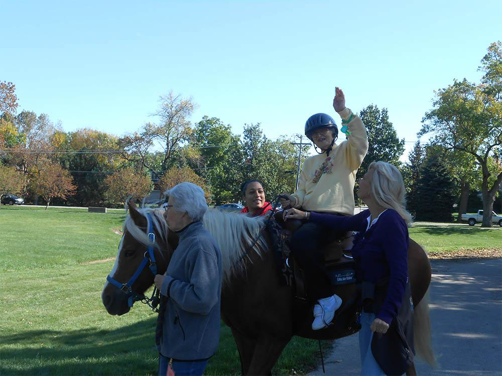 Senior Apartment Living Resident In Elk Grove Village On Horseback