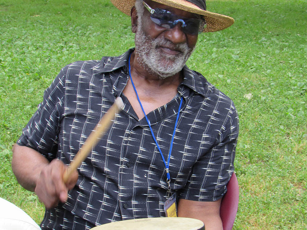Resident drumming outside at Victory Centre of Galewood