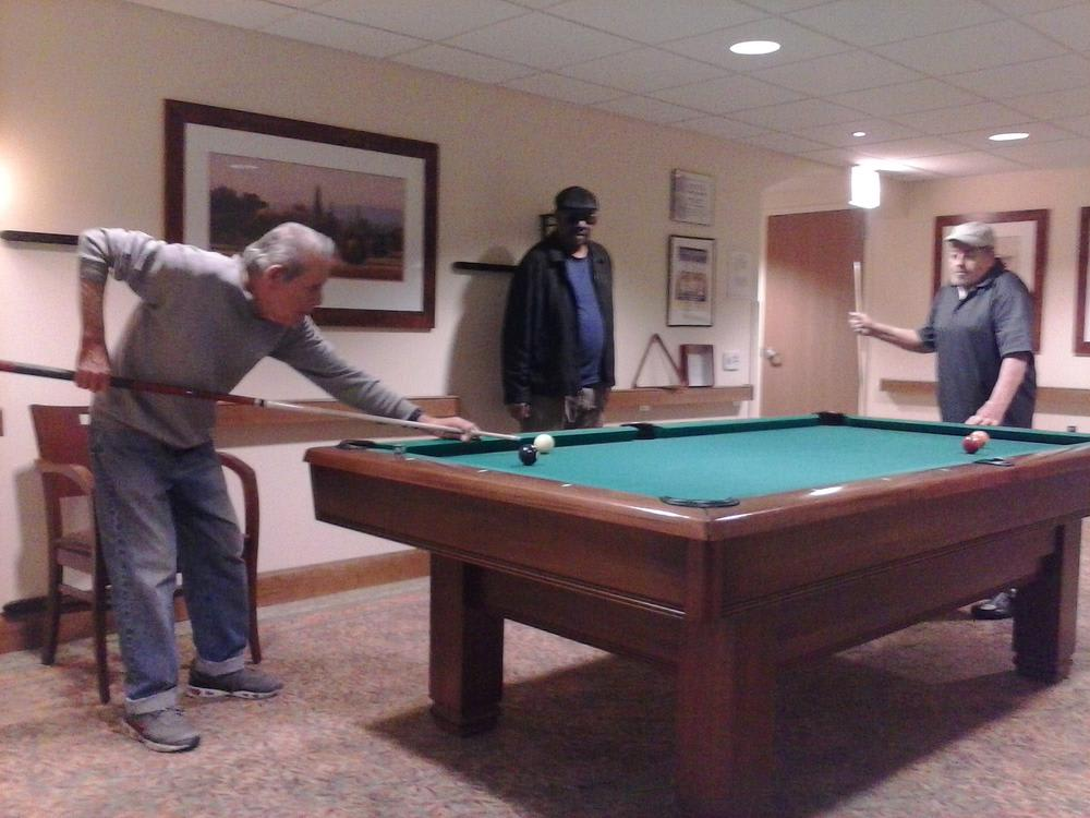 Residents playing pool at Victory Centre of Galewood in Chicago, IL