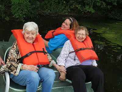 Seniors out on a boating trip in Chicago, IL