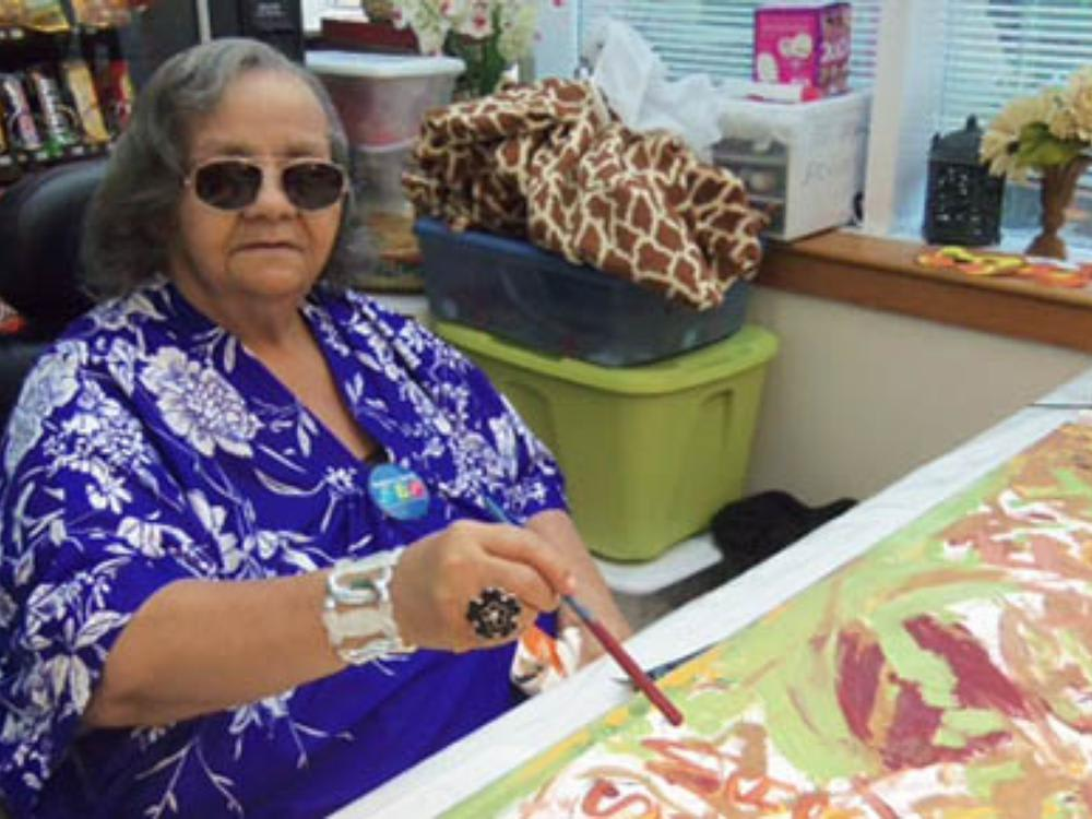 Senior resident painting at Victory Centre of Park Forest