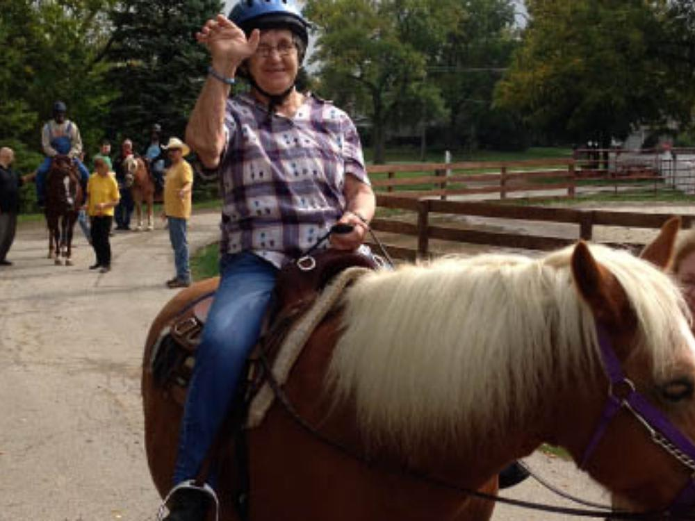 Senior resident riding a horse at Victory Centre of Park Forest