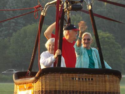 Seniors enjoying a hot air balloon ride at Victory Centre of Park Forest
