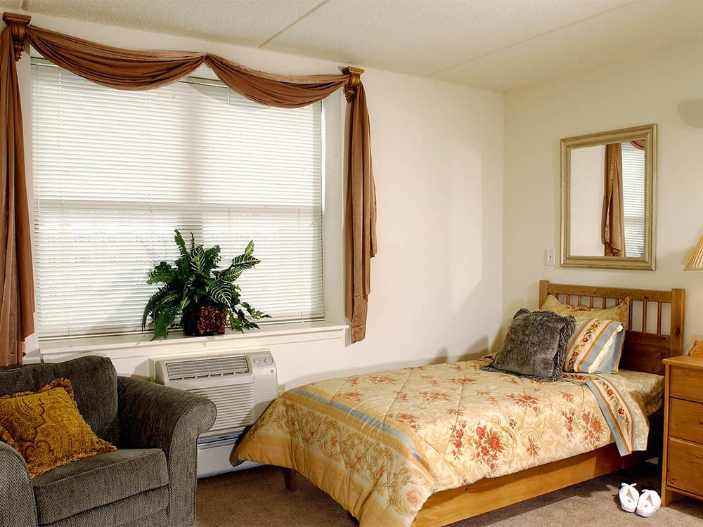 Senior Living Model Bedroom at Victory Centre of River Woods in Melrose Park