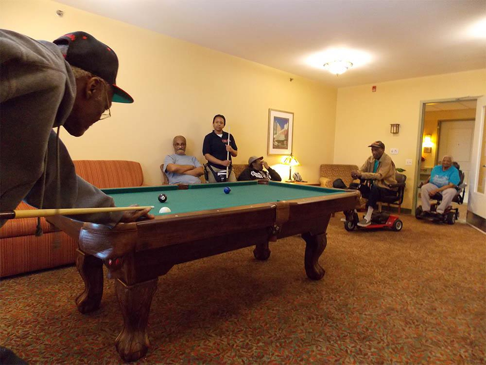 Seniors playing billiards at Victory Centre of Roseland in Chicago