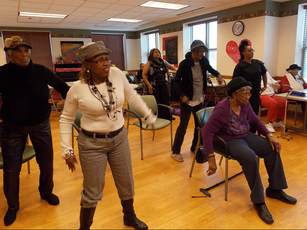 Residents dancing at Victory Centre of South Chicago in Chicago, IL