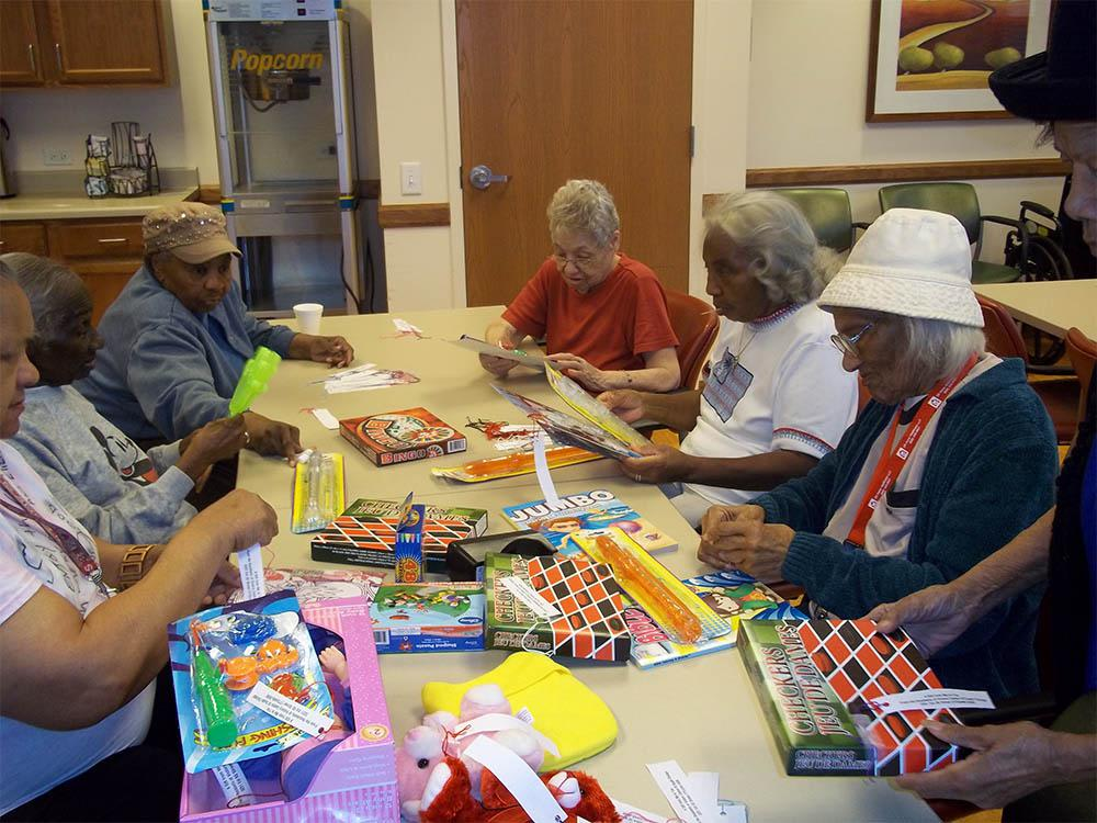 Residents playing table games together at Victory Centre of South Chicago in Chicago IL