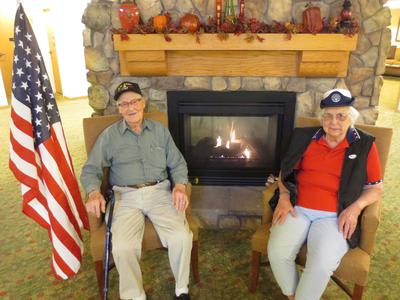Senior residents of Age Well Centre for Life Enrichment sitting by the fire