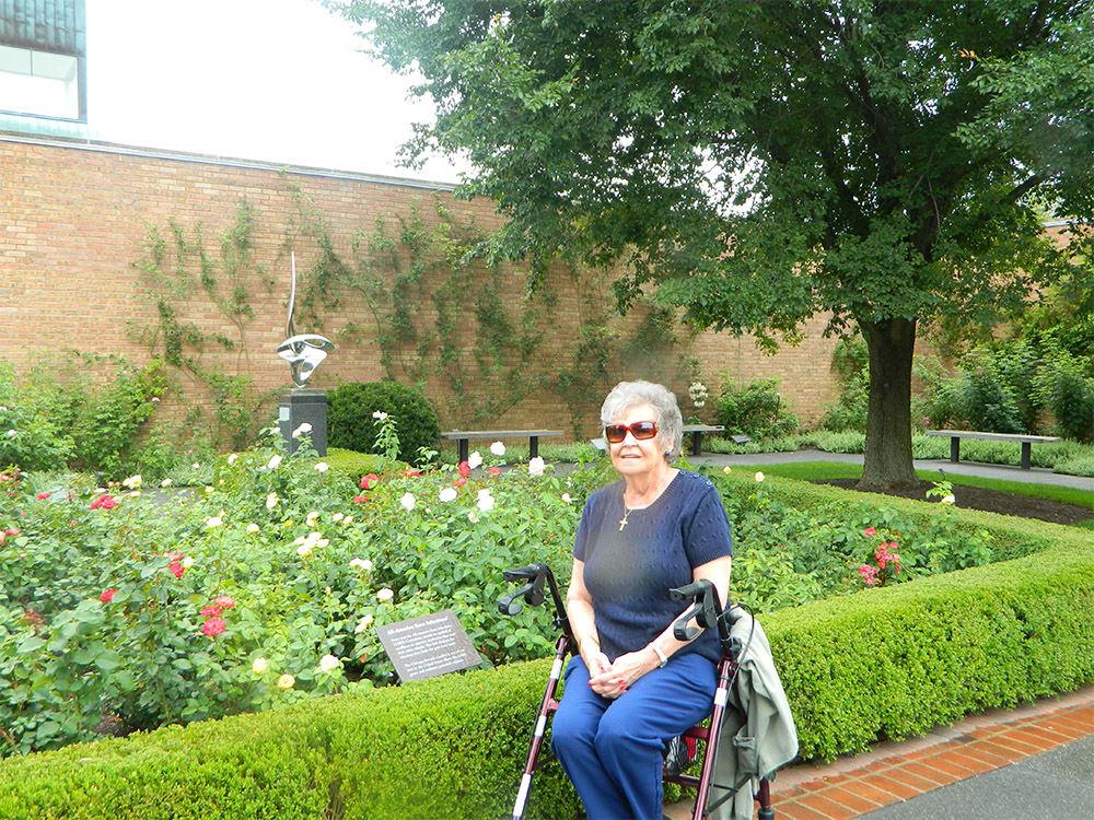 Resident outside enjoying the flowers