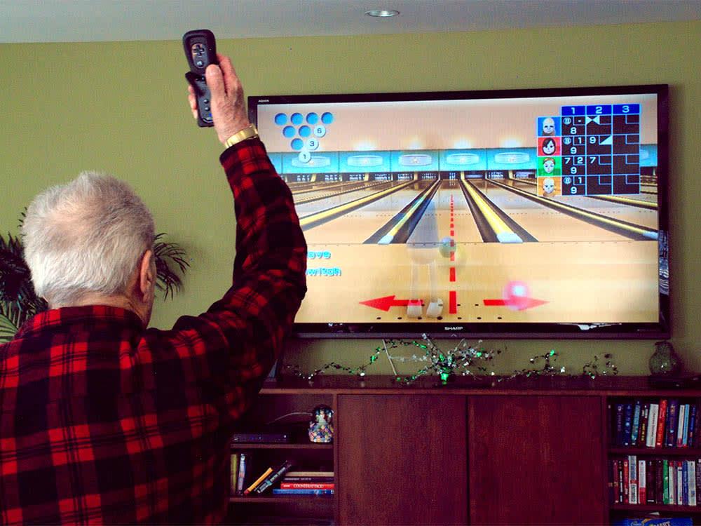 Elderly man playing wii in Round Lake Beach, IL
