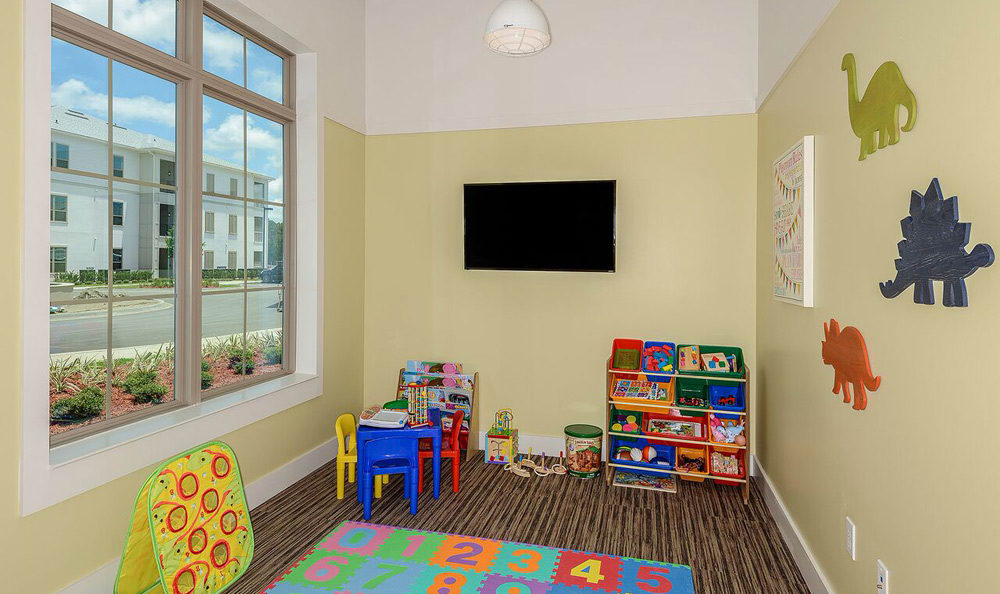 Living at Palm Bay Club includes a kids playroom and game area!