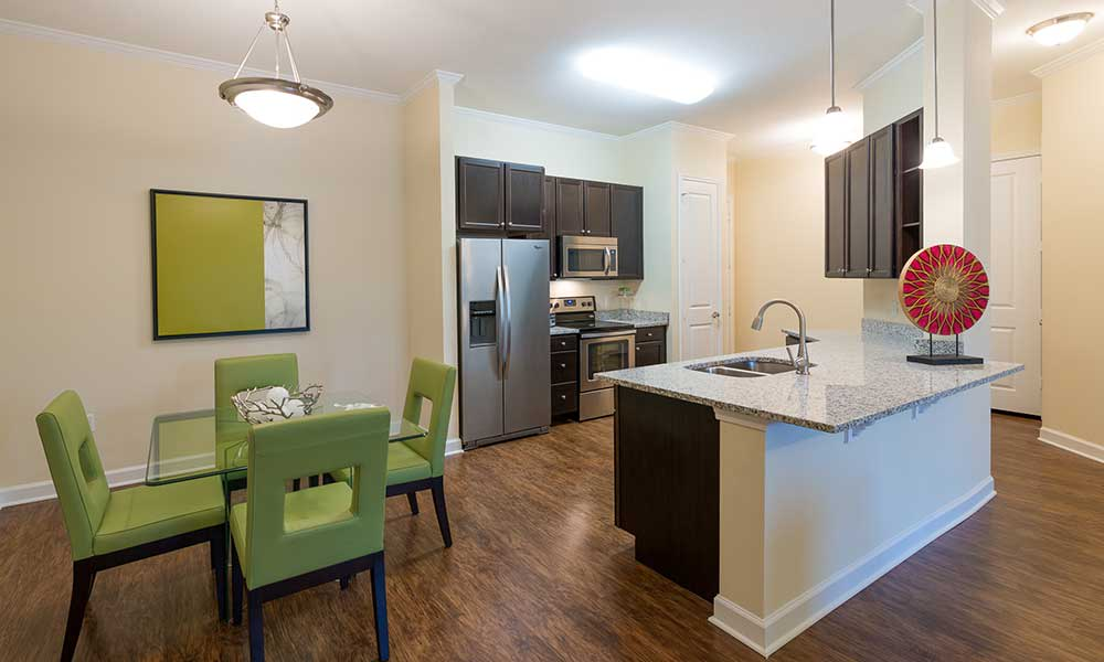 Spacious dining room and kitchen at Alaqua in Jacksonville, FL