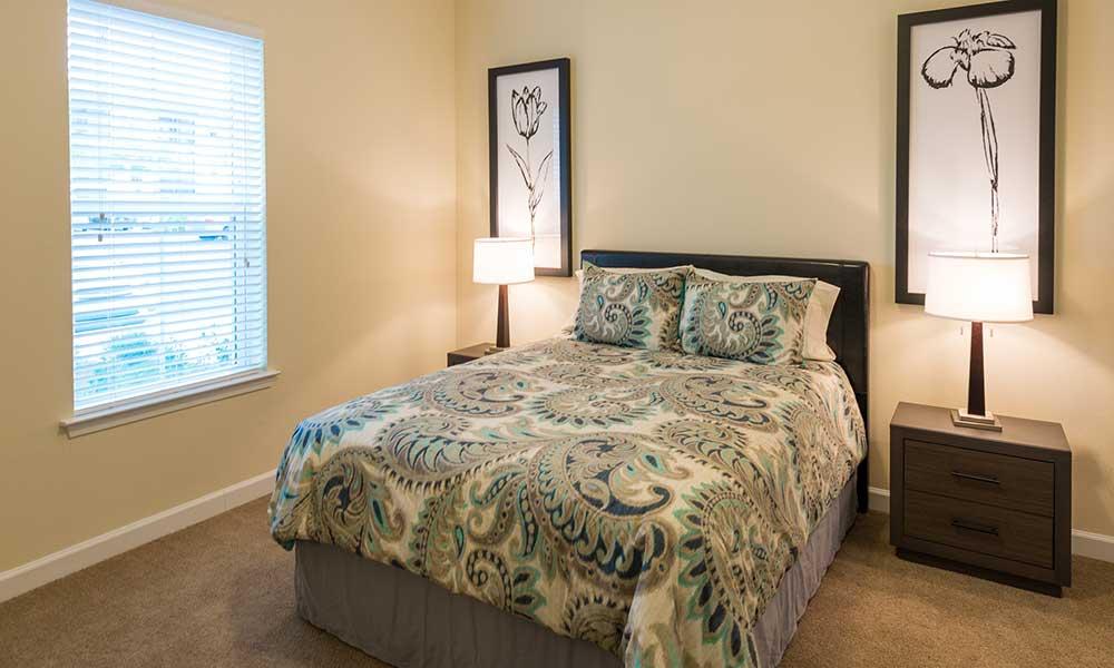 Comfortable apartment bedroom at Alaqua in Jacksonville, Florida