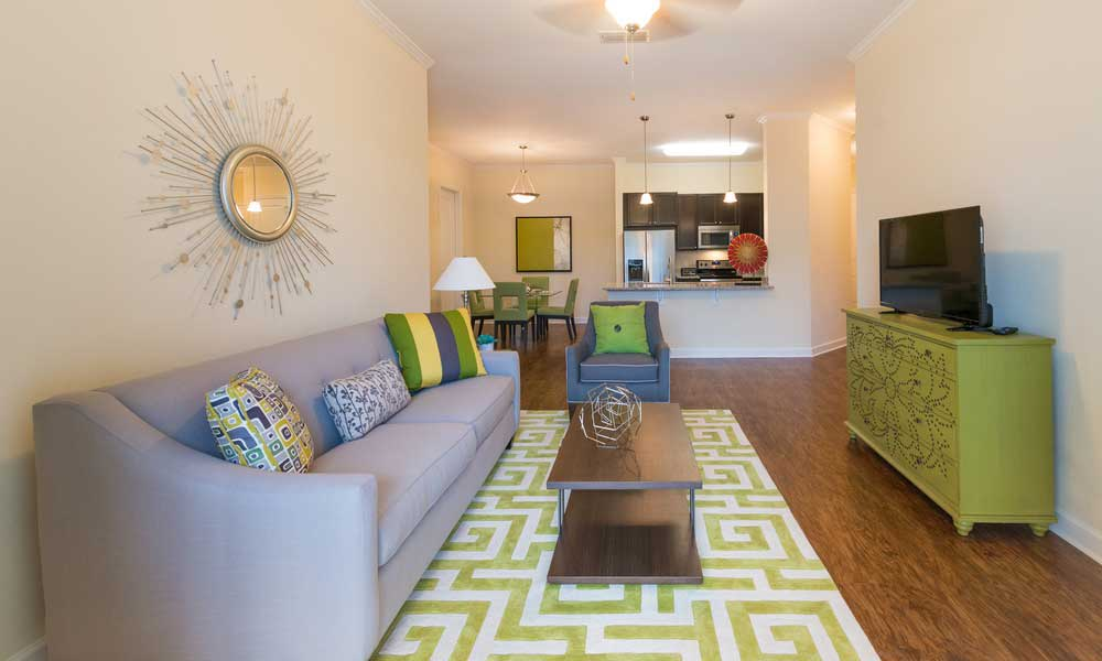 Living room and kitchen at Alaqua in Jacksonville, Florida