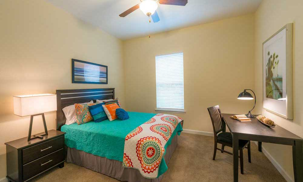 Bedroom with fan at Alaqua in Jacksonville, Florida