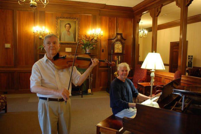 Doug and Charles having a good time doing music at The Clinton Presbyterian Community