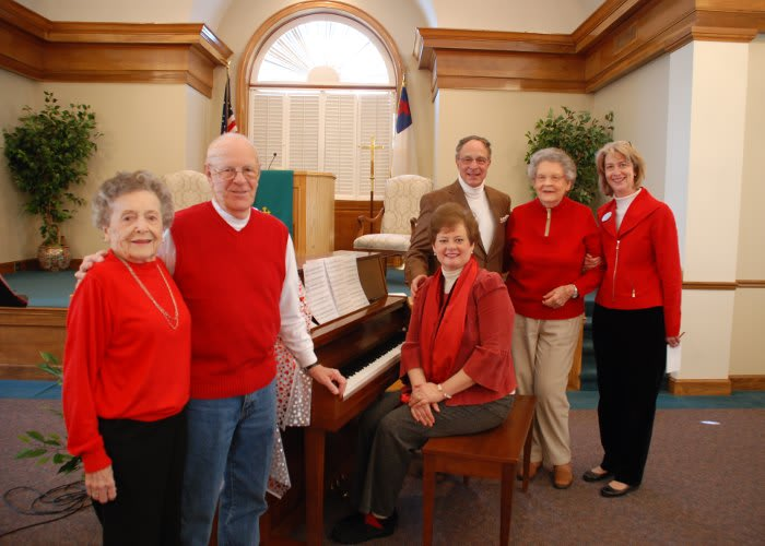 Posed at piano in activities building at The Clinton Presbyterian Community