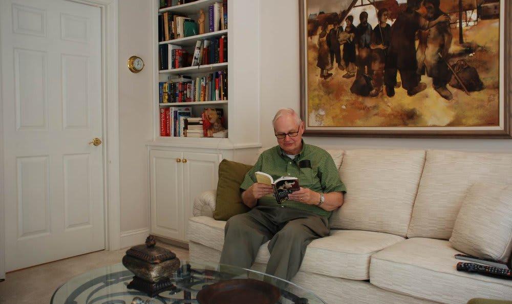 Neal reading a book at The Clinton Presbyterian Community