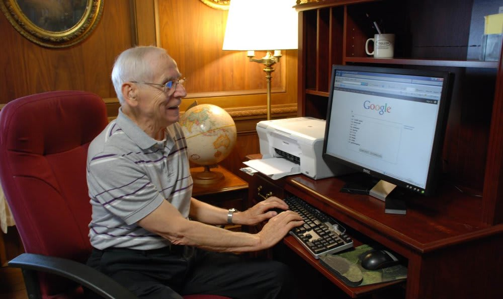 Ted at computer at The Clinton Presbyterian Community