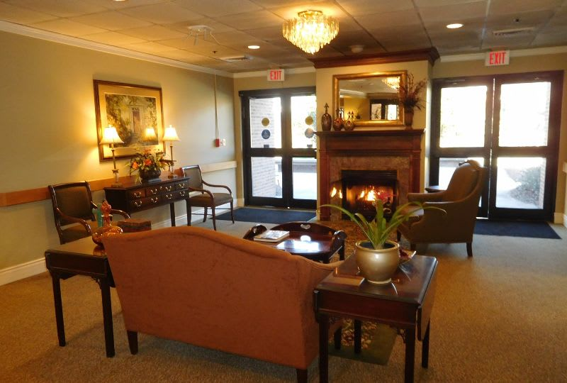 resident lounge with fireplace at The Columbia Presbyterian Community in Lexington, SC