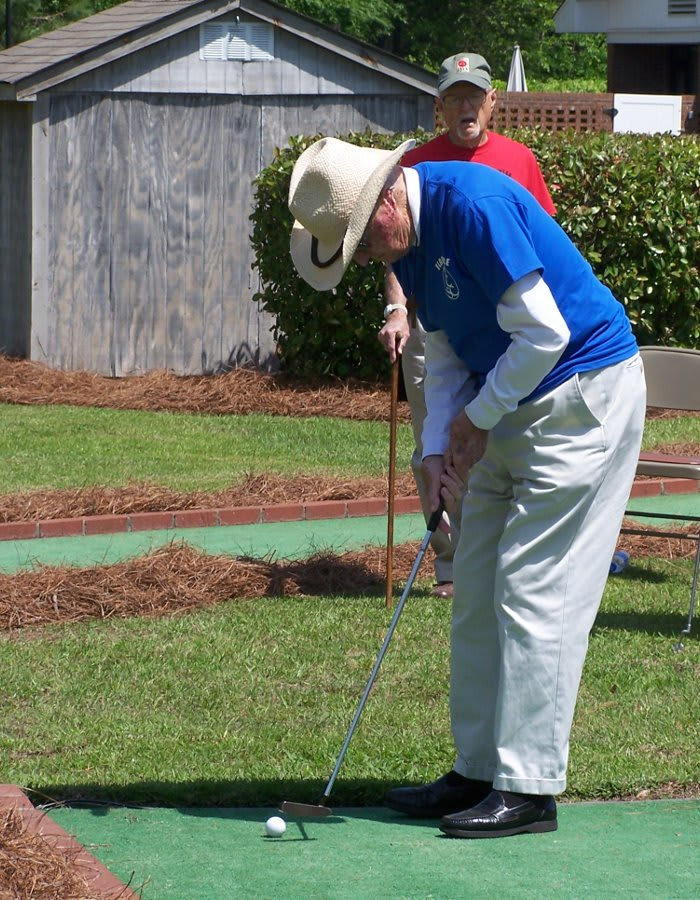 Playing golf at The Florence Presbyterian Community