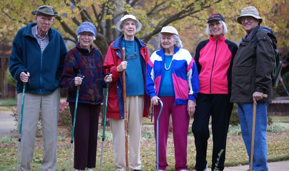 residents with walking sticks in activity at The Foothills Presbyterian Community in Easley, SC