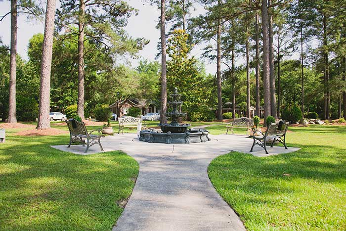 Enjoy the soothing effect of the front fountain at The Village at Summerville