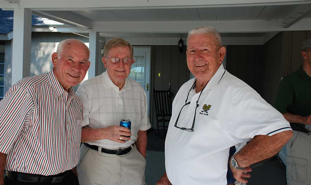 Some friends at The Village at Summerville enjoy an outdoor event.