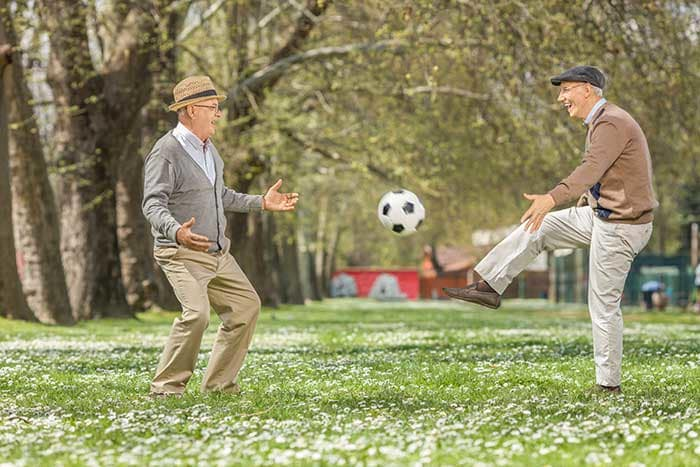 Senior living doesn't have to be boring. Kick a ball and laugh at The Village at Summerville.