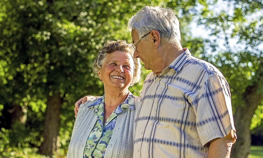 Senior couple walking together outdoors at Presbyterian Communities of South Carolina