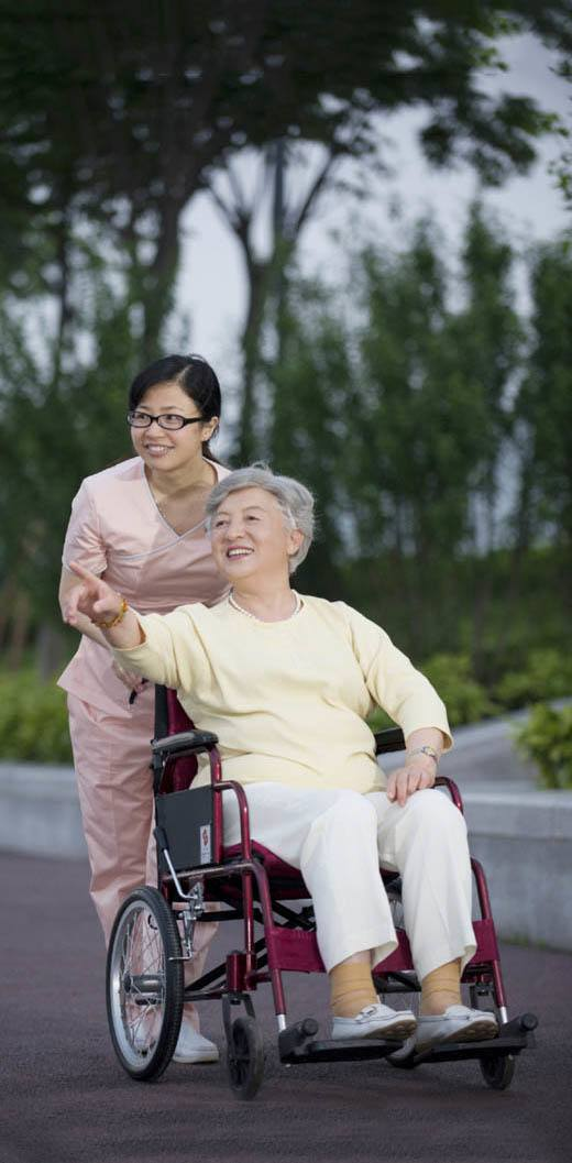 Nurse and resident getting fresh air at our senior living community in Pudong