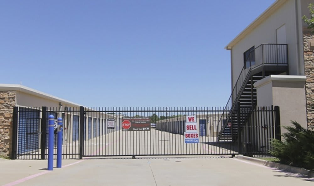 Secure gate in front of storage facility