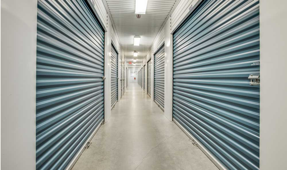 Wide lit hallways at Advantage Storage - Frisco / Stonebriar in Frisco, TX