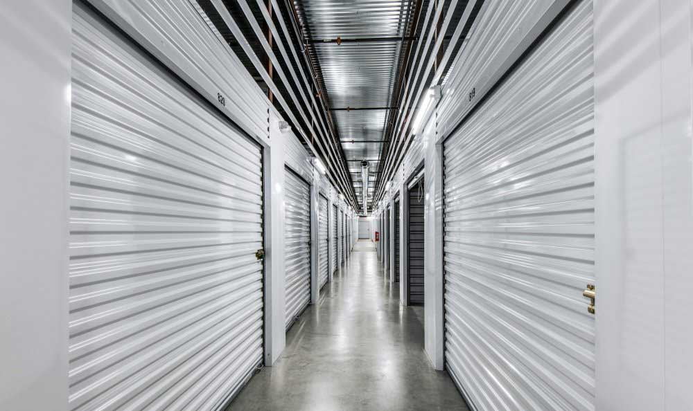 Well lit hallways at Advantage Storage - Plano Superior in Plano, TX