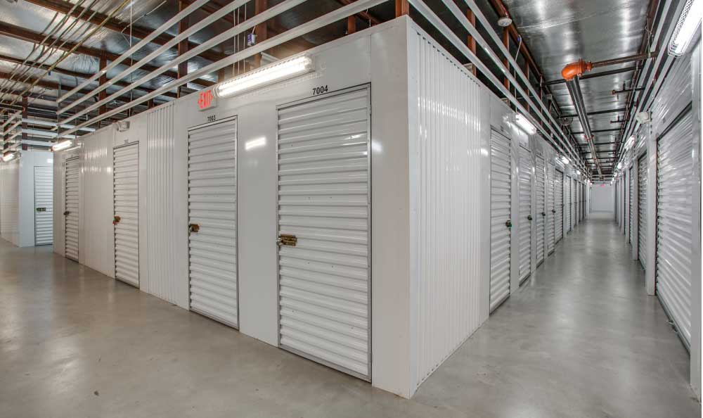 Well lit hallways at Advantage Storage - McKinney East Craig Ranch.