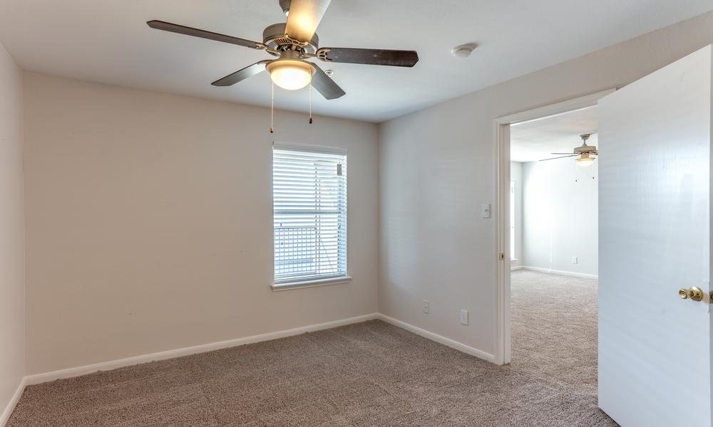 White Empty Bedroom at Sutter Ranch Apartments in Houston, TX