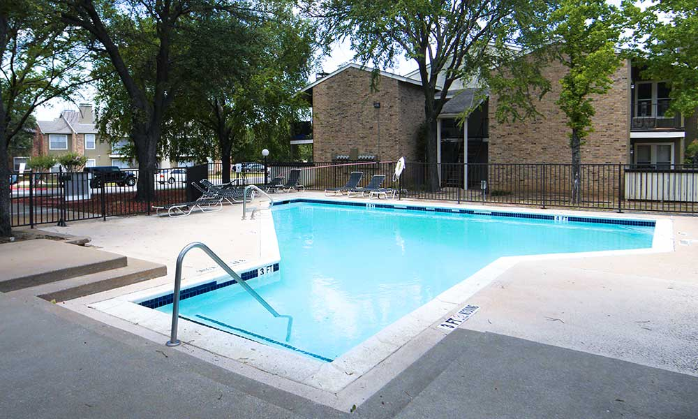Keep cool from the Texas heat and take a dip in the pool at Fairway on the Park.