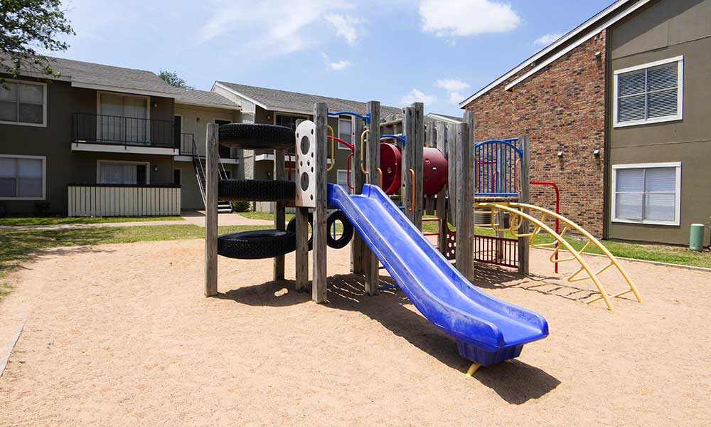 Children can play on the awesome playground at Fairway on the Park