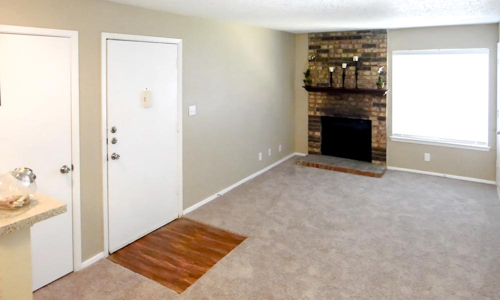 Living Room With Chimney at Savoy Apartments in Fort Worth