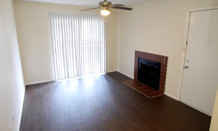 Sedona Square Apartments offers living rooms with a fireplace in Houston, TX
