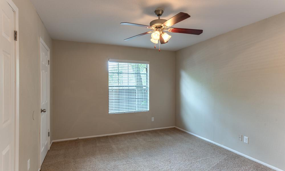 White Empty Living Room at The Bridge at Shady Hill in Baytown, TX