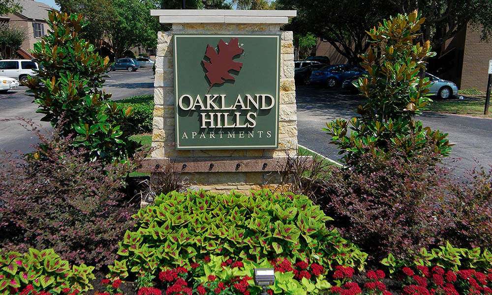 Sign and flower garden outside of Oakland Hills