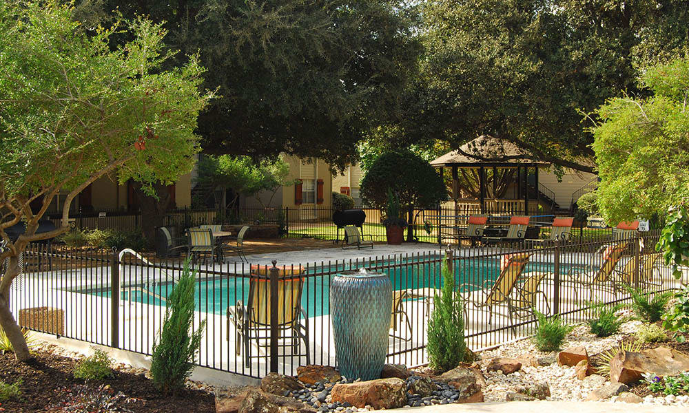 Poolside view of Toscana Apartments
