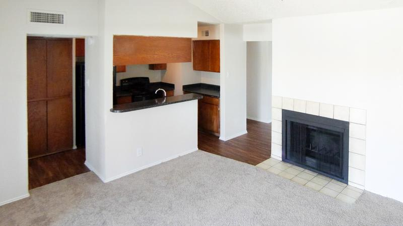 Verona Apartments offers a beautiful living room with chimney in Fort Worth, TX