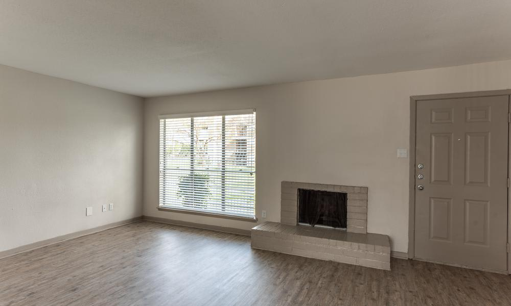 Living Room With Chimney at Element Apartments in Houston, TX