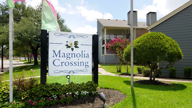 Sign for apartments at Magnolia Crossing in Fort Worth, TX