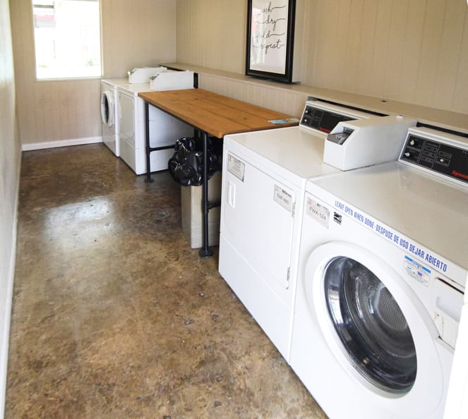 Laundry room at Houston apartments in Newport at Clear Lake